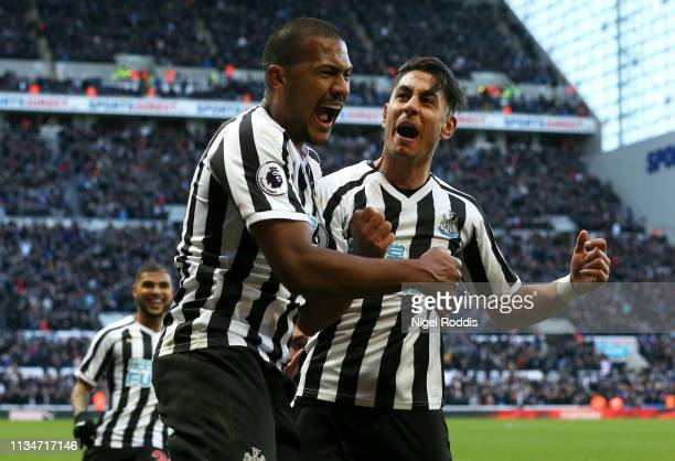 Ayoze Perez of Newcastle United celebrates with teammate Salomon Rondon after scoring his team's third goal during the Premier League match between...