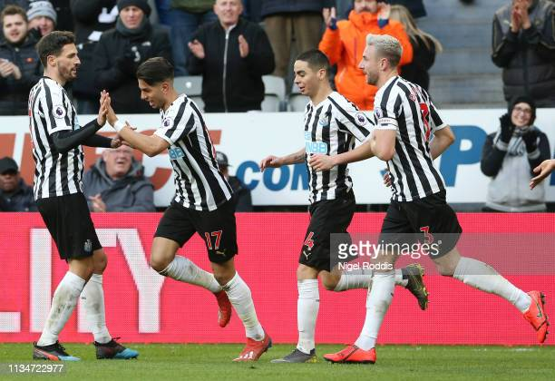 Ayoze Perez of Newcastle United celebrates with teammates after scoring his team's second goal during the Premier League match between Newcastle...