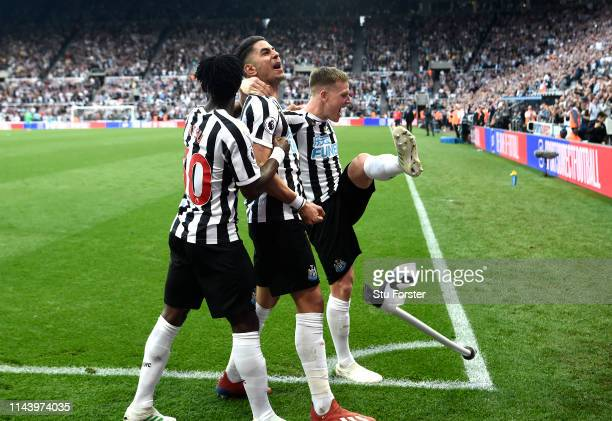 Ayoze Perez of Newcastle United celebrates with teammates after scoring his team's third goal during the Premier League match between Newcastle...