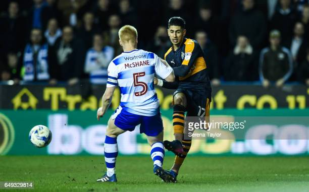 Ayoze Perez of Newcastle United has his strike blocked by Paul McShane of Reading during the Sky Bet Championship Match between Reading and Newcastle...