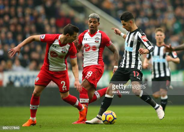 Ayoze Perez of Newcastle United is challenged by Cedric Soares and Mario Lemina of Southampton during the Premier League match between Newcastle...