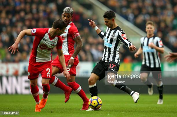 Ayoze Perez of Newcastle United is challenged by Cedric Soares of Southampton and Mario Lemina of Southampton during the Premier League match between...