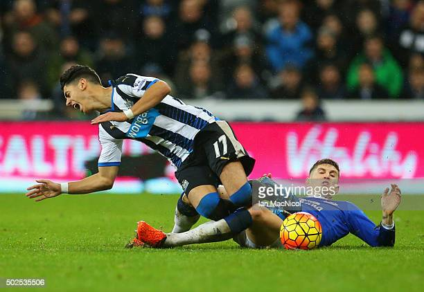 Ayoze Perez of Newcastle United is challenged by John Stones of Everton during the Barclays Premier League match between Newcastle United and Everton...