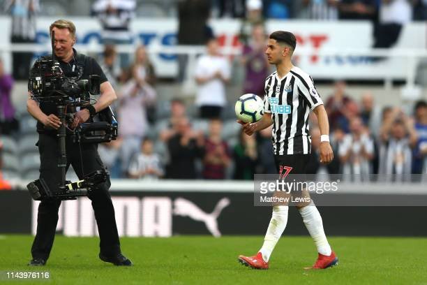 Ayoze Perez of Newcastle United leaves the pitch with the match ball following his hat-trick during the Premier League match between Newcastle United...