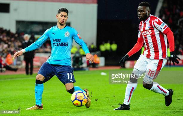 Ayoze Perez of Newcastle United looks to control the ball whilst being challenged by Mame Diouf of Stoke City during the Premier League match between...