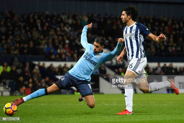 Ayoze Perez of Newcastle United misses a chance under pressure from Ahmed ElSayed Hegazi of West Bromwich Albion during the Premier League match...