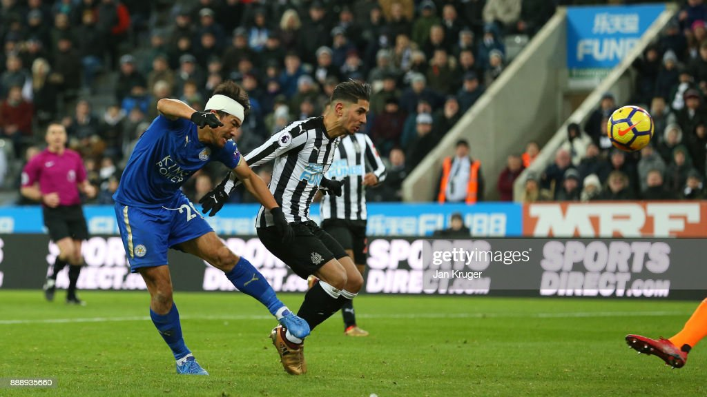 Ayoze Perez of Newcastle United scores an own goal under pressure from Shinji Okazaki of Leicester City during the Premier League match between Newcastle United and Leicester City at St. James Park on December 9, 2017 in Newcastle upon Tyne, England.