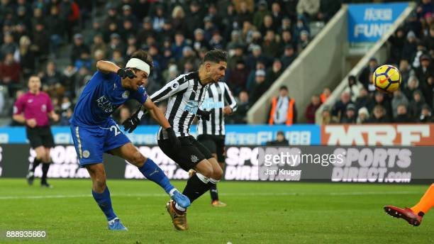 Ayoze Perez of Newcastle United scores an own goal under pressure from Shinji Okazaki of Leicester City during the Premier League match between...