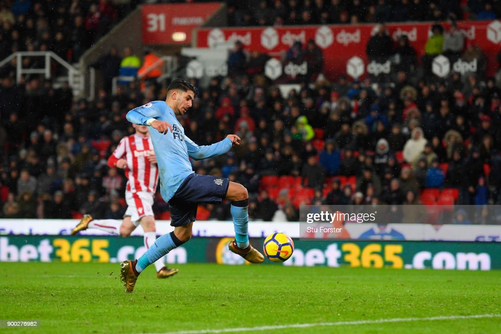 Ayoze Perez of Newcastle United scores his sides first goal during the Premier League match between Stoke City and Newcastle United at Bet365 Stadium on January 1, 2018 in Stoke on Trent, England.