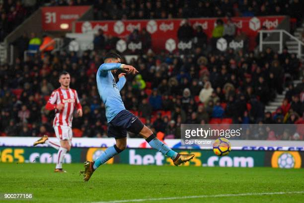 Ayoze Perez of Newcastle United scores his sides first goal during the Premier League match between Stoke City and Newcastle United at Bet365 Stadium...