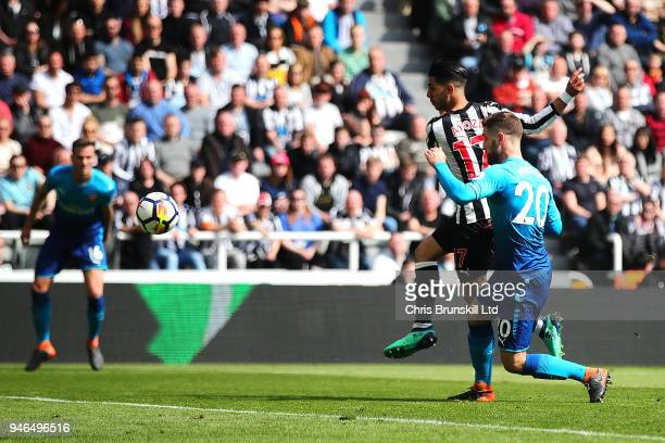 Ayoze Perez of Newcastle United scores his side's first goal during the Premier League match between Newcastle United and Arsenal at St. James Park...