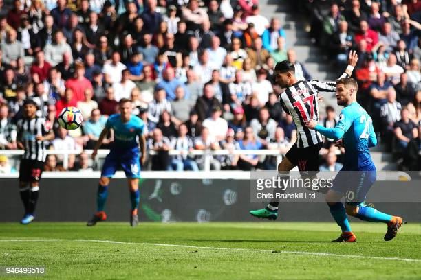 Ayoze Perez of Newcastle United scores his side's first goal during the Premier League match between Newcastle United and Arsenal at St James Park on...