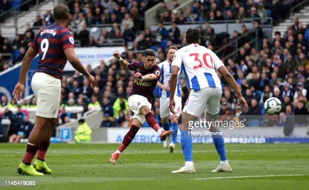 Ayoze Perez of Newcastle United scores his team's first goal during the Premier League match between Brighton & Hove Albion and Newcastle United at...