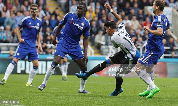 Ayoze Perez of Newcastle United scores his team's first goal during the Barclays Premier League match between Newcastle United and Chelsea at St...