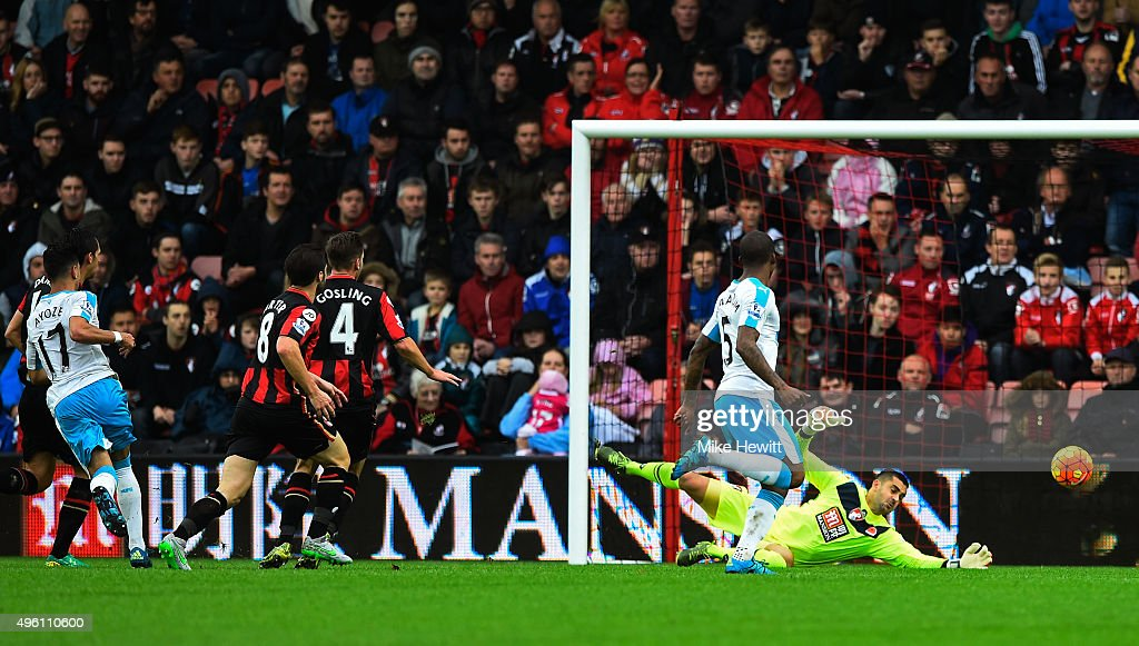Ayoze Perez (1st L) of Newcastle United scores his team's first goal past Adam Federici (1st R) of Bournemouth during the Barclays Premier League match between A.F.C. Bournemouth and Newcastle United at Vitality Stadium on November 7, 2015 in Bournemouth, England.