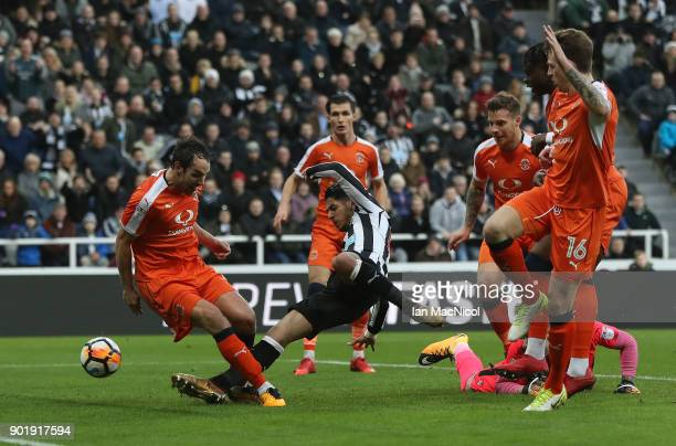 Ayoze Perez of Newcastle United scores the opening goal during the Emirates FA Cup third round match between Newcastle United and Luton Town at St...