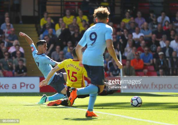 Ayoze Perez of Newcastle United shoots and scores his side's first goal during the Premier League match between Watford and Newcastle United at...
