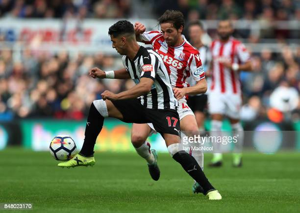 Ayoze Perez of Newcastle United vies with Joe Allen of Stoke City during the Premier League match between Newcastle United and Stoke City at St James...