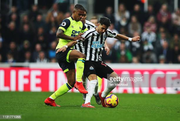 Ayoze Perez of Newcastle United vies with Juninho Bacuna of Huddersfield Town during the Premier League match between Newcastle United and...