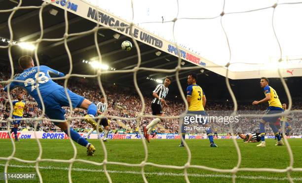 Ayoze Perez scores his and Newcastle's third and hat trick goal past goalkeeper Angus Gunn during the Premier League match between Newcastle United...