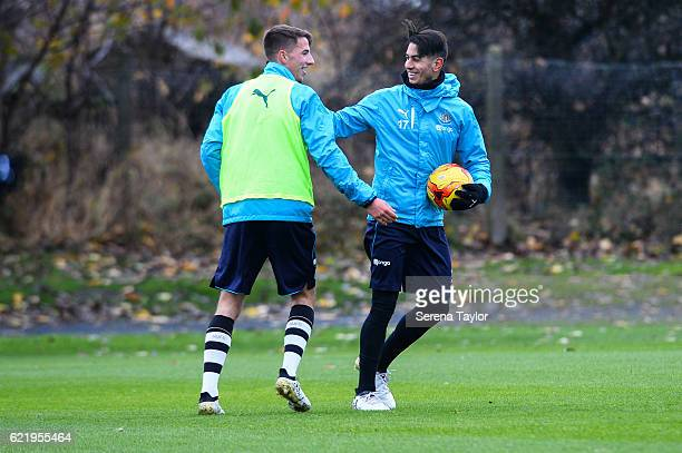 Ayoze Perez smiles with U23 player Dan Barlaser during The Newcastle United Training Session at The Newcastle United Training Centre on November 9...