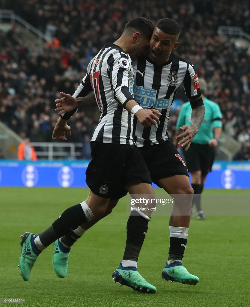 Ayoze Perze of Newcastle United celebrates with team mate Kennedy after scoring the only goal of the game during the Premier League match between Newcastle United and Huddersfield Town at St. James Park on March 31, 2018 in Newcastle upon Tyne, England.