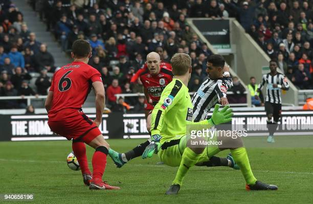 Ayoze Perze of Newcastle United scores the only goal of the game during the Premier League match between Newcastle United and Huddersfield Town at St...
