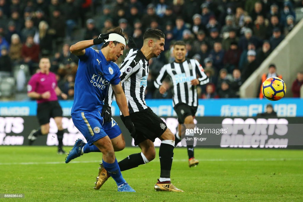 Ayozi Perez of Newcastle United scores an own goal under pressure from Shinji Okazaki of Leicester City during the Premier League match between Newcastle United and Leicester City at St. James Park on December 9, 2017 in Newcastle upon Tyne, England.