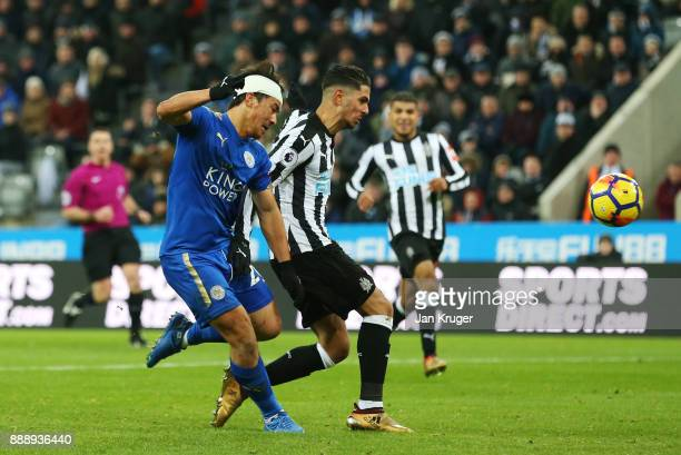 Ayozi Perez of Newcastle United scores an own goal under pressure from Shinji Okazaki of Leicester City during the Premier League match between...