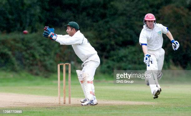 Aberdeenshire's Todd Astle makes it back to the crease despite Dunfermline Knights wicket keeper Sanjay Rakshit attempts to oust him