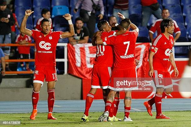 Ayron del Valle of America de Cali celebrate after scoring during a match between America de Cali and Leones FC as part of 13th round of second leg...
