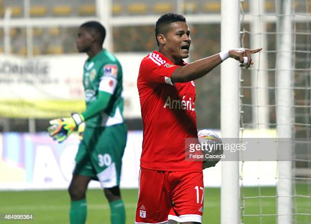 Ayron del Valle of America de Cali celebrates after scoring the third goal of his team from the penalty spot during a match between America de Cali...