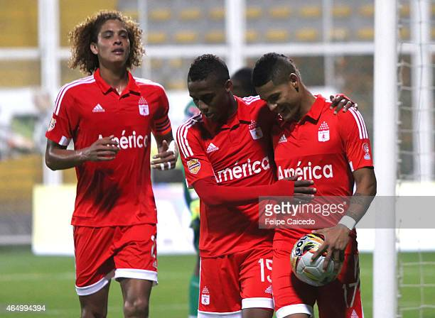 Ayron del Valle of America de Cali celebrates with his teammate after scoring the third goal of his team from the penalty spot during a match between...