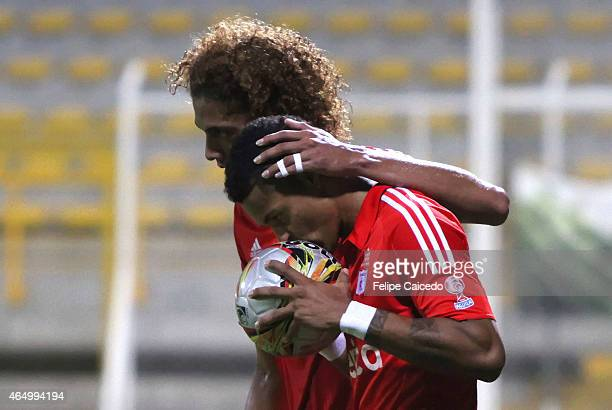 Ayron del Valle of America de Cali celebrates with his teammates Stiven Tapiero after scoring the third goal of his team from the penalty spot during...