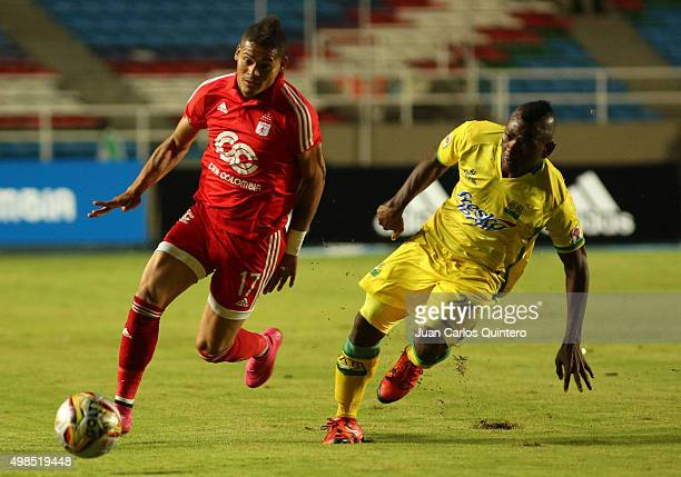 Ayron del Valle of América and Jarol Martinez of Bucaramanga fight for the ball during a match between America de Cali and Bucaramanga as part of...