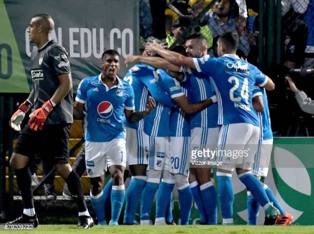 Ayron del Valle of Millonarios celebrates with teammates after scoring the first goal of his team during the first leg match for the quarterfinals of...