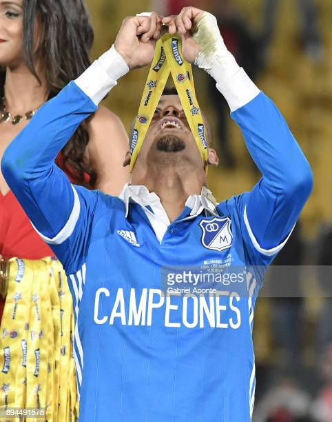 Ayron del Valle of Millonarios lifts his medal to celebrate after winning the second leg match between Millonarios and Santa Fe as part of the Liga...