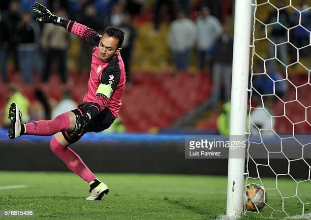 Ayron Del Valle of Millonarios shoot to score the opening goal to Ricardo Jerez goalkeper of Alianza Petrolera during a match between Millonarios and...
