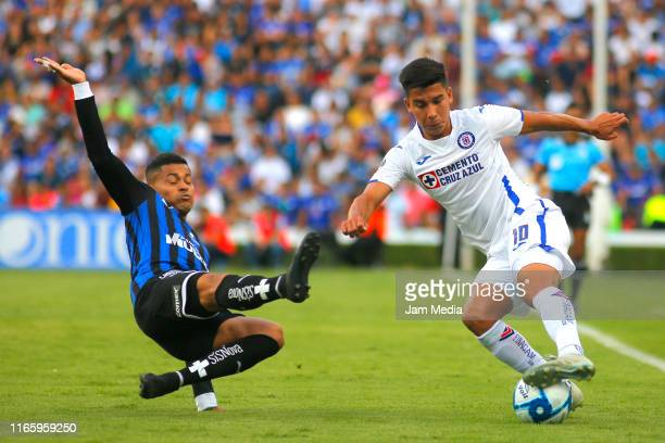 Ayron Del Valle of Queretaro fights for the ball with Guillermo Fernandez of Cruz Azul during the 3rd round match between Queretaro and Cruz Azul as...