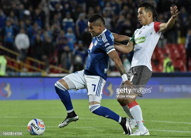Ayron del Valle of Millonarios fights for the ball with Ray Vanegas of Once during a match between Millonarios and Once Caldas as part of Liga Aguila...