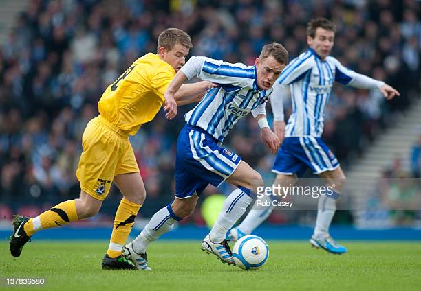 Ayr's Jamie McKernon and Killie's Dean Shiels in action during the Scottish Communities Cup Semi Final match between Ayr United and Kilmarnock at...