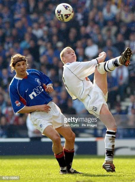 Ayr's Paul Lovering sweeps the ball over the head of Rangers' Claudio Caniggia during their CIS Insurance League Cup Final at Hampden Park in Glasgow