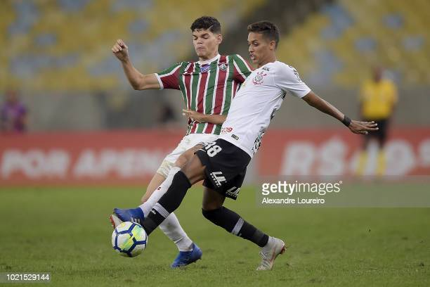 Ayrton Lucas of Fluminense struggles for the ball with Pedrinho of Corinthians during the match between Fluminense and Corinthians as part of...