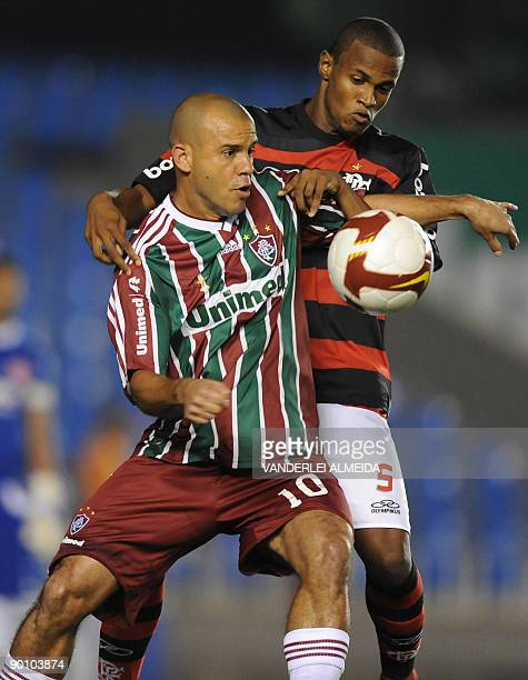 Ayrton of Brazilian Flamengo vies for the ball with Roni of Brazilian Fluminense during their Copa Sudamericana football match on August 26 2009 at...