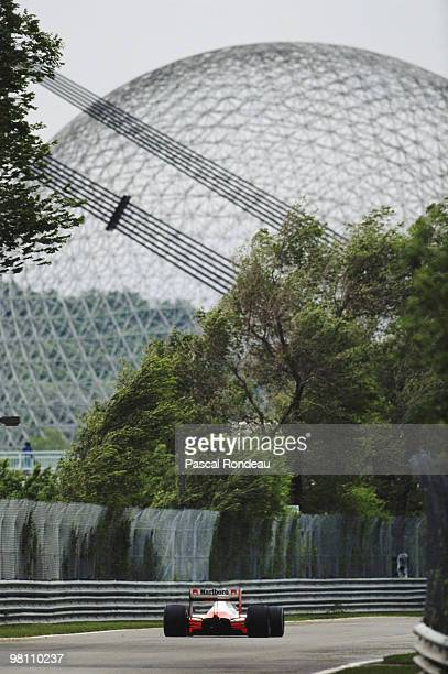 Ayrton Senna drives the McLaren-Honda MP4/5 with the Expo 67 Biosphere as a backdrop during the Canadian Grand Prix on 18 June 1989 at the Montreal...