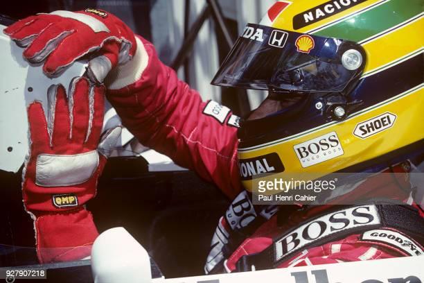 Ayrton Senna McLarenHonda MP4/7A Grand Prix of France Circuit de Nevers MagnyCours 05 July 1992 Ayrton Senna checking his monitor during practice for...