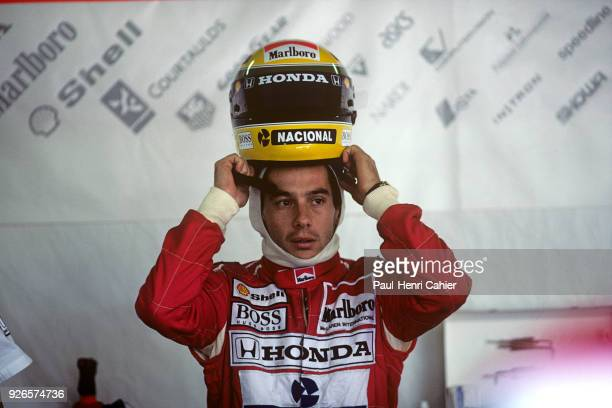 Ayrton Senna McLarenHonda MP4/7A Grand Prix of San Marino Autodromo Enzo e Dino Ferrari Imola 17 May 1992 Ayrton Senna putting on his helmet before...
