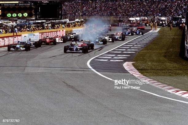 Ayrton Senna Michael Schumacher WilliamsRenault FW16 BenettonFord B194 Grand Prix of San Marino Autodromo Enzo e Dino Ferrari Imola 01 May 1994 Start...