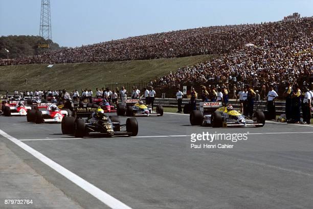 Ayrton Senna, Nelson Piquet, Lotus-Renault 98T, Williams-Honda FW11, Grand Prix of Hungary, Hungaroring, 10 August 1986. Ayrton Senna's Lotus-Renault...