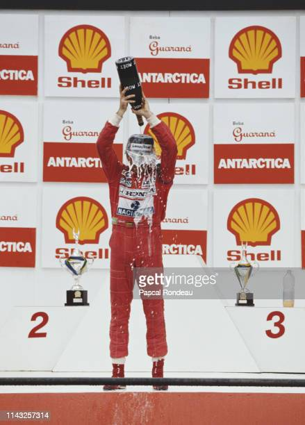 Ayrton Senna of Brazil and driver of the Honda Marlboro McLaren MP4-6 Honda pours Moet et Chandon champagne over himself as he celebrates winning the...
